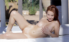 Cute Redhead Teen Pours Oil Over her Whole Sexy Naked Body